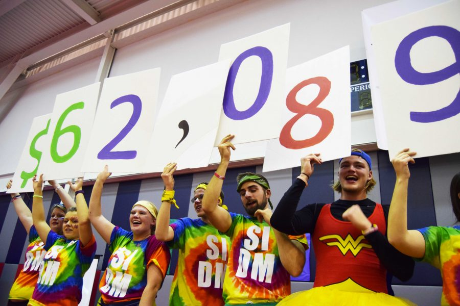 Dance Marathon board members hold up the fundraising total of $62,089.24.  That amount includes all of the donations made to Riley Hospital through the Southern Indiana Dance Marathon.