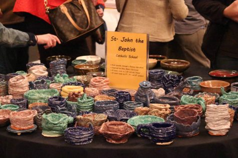 A table is filled with bowls Saturday afternoon at Sauced for the Empty Bowls event. Participants were able to choose a bowl from the choices to purchase for $10 toward charity.