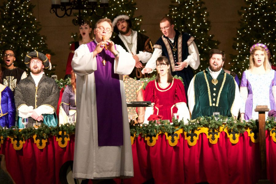 The choir sings during the 2014 Madrigal Feaste in Carter Hall.