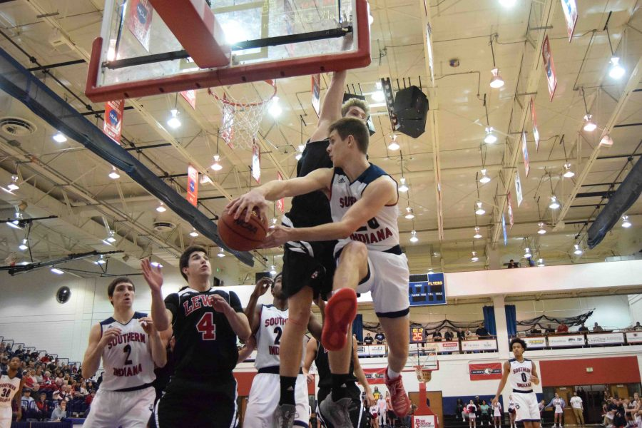 Alex Stein, a sophomore guard, goes for the wrap around pass against Lewis.