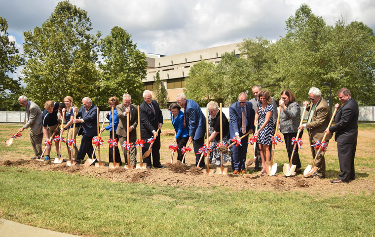 Student ambassadors, administration and members of the Fuquay family break ground at the Sep. 1 groundbreaking ceremony.