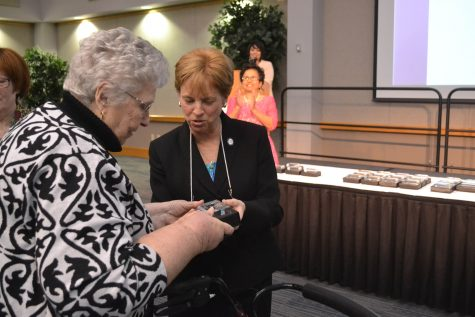 Marcia Kiessling, associate provost for Student Affairs and Betty Rice, wife of former university president David Rice, admire Rice's award at the 2015 Phenomenal Women Ceremony. Rice helped link the university to the rest of the Evansville community and would plan and hosts events on the campus during her time here.