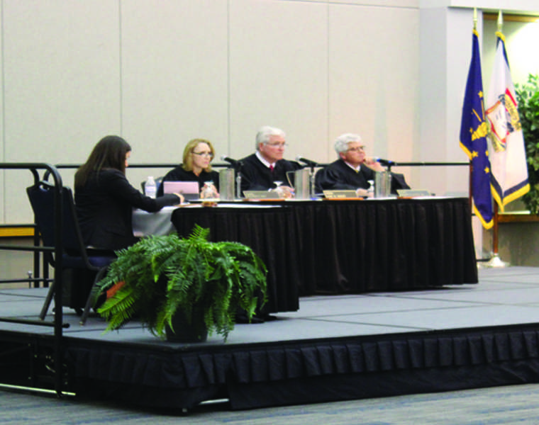 The Court of Appeals of Indiana listen to oral arguments in the case of Melvin Wolfe v. State during the seventh annual Law Day March 29, in Carter Hall. The case concerns a dispute over a battery charge, where Wolfe claimed self-defense in a bench trial. Law Day also featured keynote speaker Dr. Stephen L. Wasby.