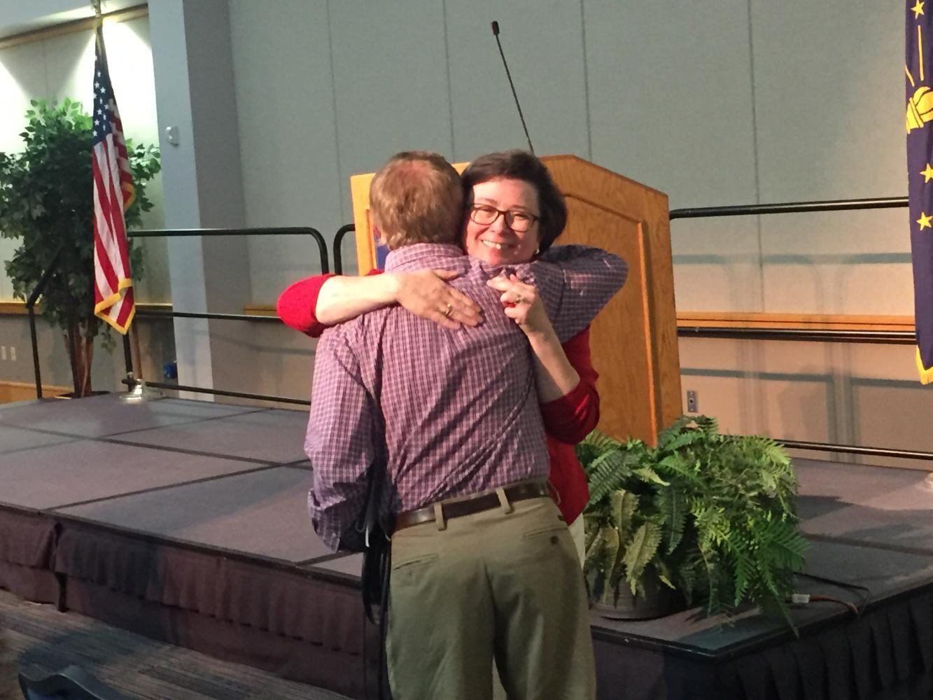 University President shares a hug after announcing her retirement at an August faculty meeting. The Faculty Senate will vote on candidates to serve on the search committee for the next President of the university following a public forum Friday