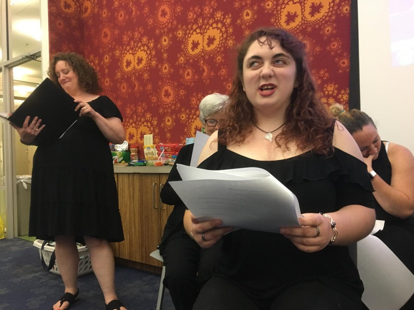 Junior philosophy and theatre major Andrea Morgan Doyle reads lines for one of the plays presented by the STAGEtwo Playwriting Workshop participants and community actors. Dale wrote a play that her fellow students performed at the event Friday evening.