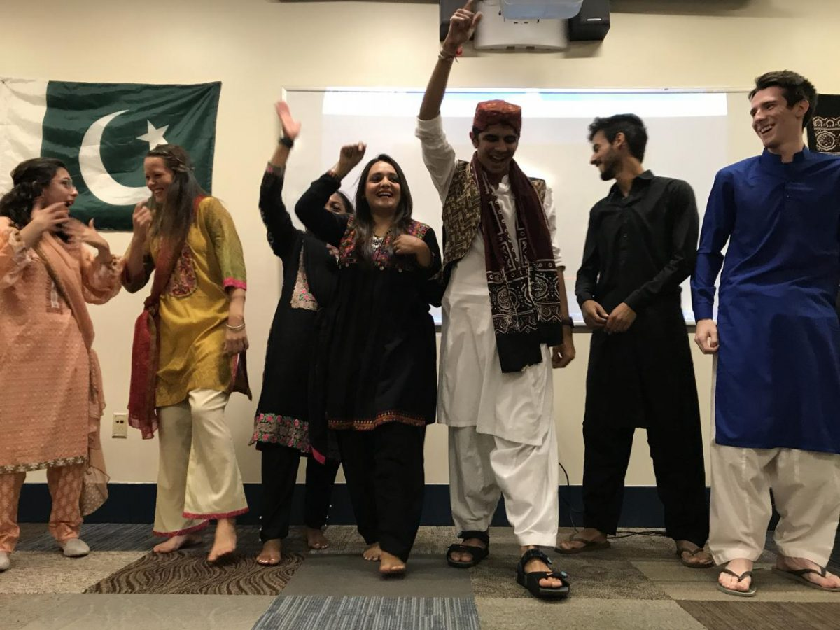 Students with the Center for International Programs cheer after performing a dance routine during the Pakistani cultural night at Ruston Hall Wednesday night. The Pakistani night was one of several cultural nights that will take place throughout the semester.