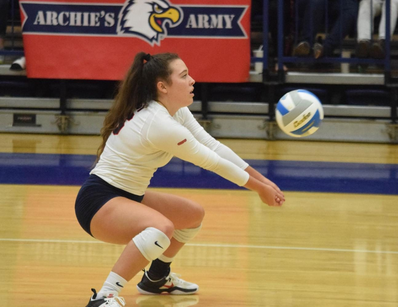 Haley Limper, junior defensive specialist, prepares to hit the ball.