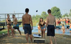 Students blasted music from a single speaker as they played game after game of Cornhole at Labor Day at the Lake Monday afternoon. Students enjoyed a variety of other games such as beach volleyball and soccer.