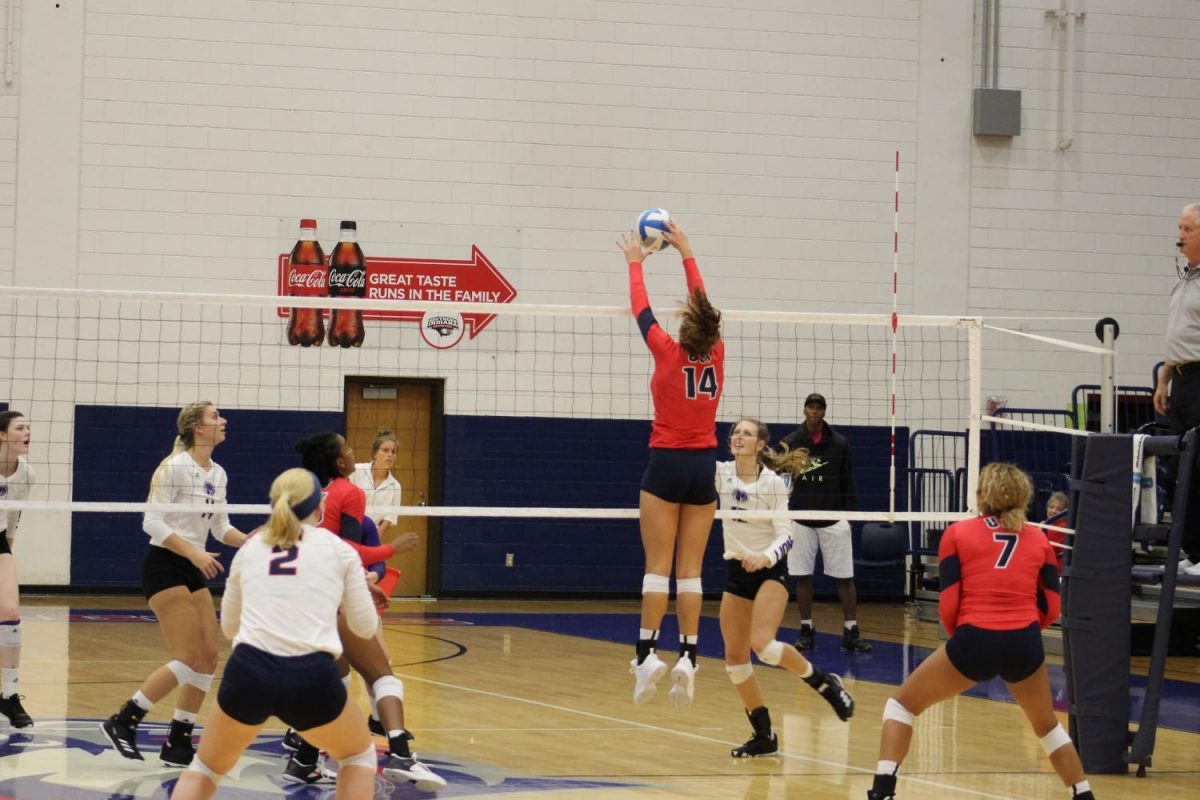 Amanda+Jung%2C+a+sophomore+middle-blocker+jumps+and+spikes+the+ball+over+the+net+Saturday+afternoon+in+the+PAC.+The+Screaming+Eagles+lost+to+the+University+of+Wisconsin-Parkside+3-2.
