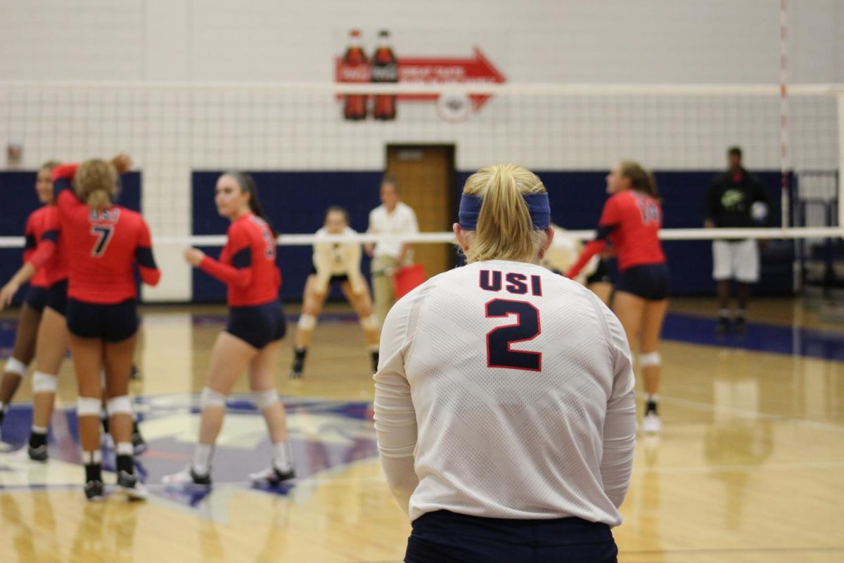 Shannon Farrell, a senior defensive specialist stares down the court during the game Saturday afternoon.