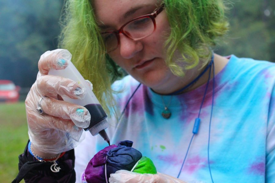 Anika Cunningham, freshman English literature major, participates in tie-dying at the event hosted by SAGA in honor of National Coming Out Day Wednesday evening.