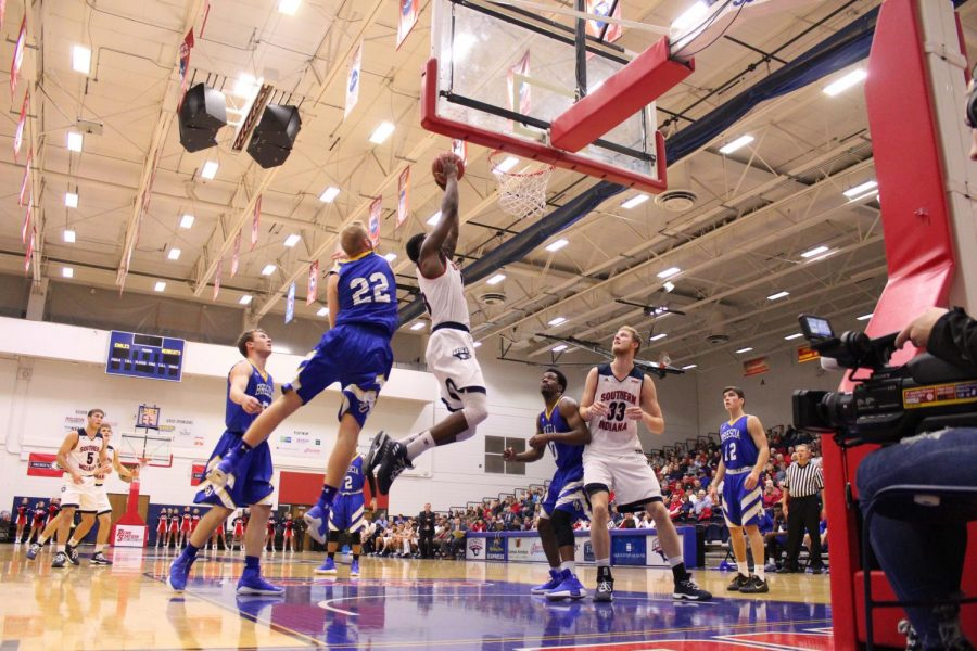 •DayJar Dickinson (23), a senior forward, dunks the ball, passing a defender and scored against Brescia University on Tuesday in the PAC