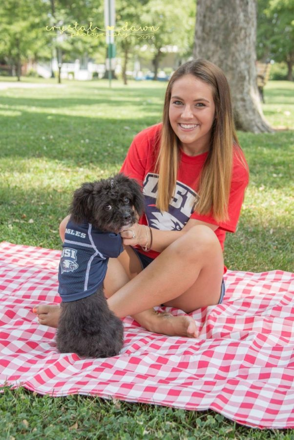 Mercades Axton, freshman nursing major, sits with her emotional support animal Henley, as they sport USI apparel. Henley has been Axton's emotional support animal for five years.