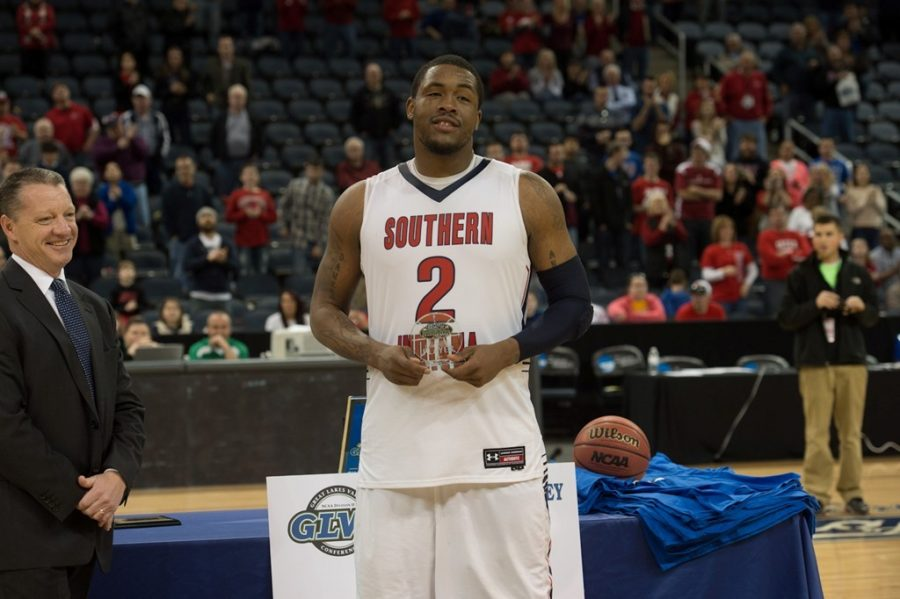 Aaron Nelson receiving the GLVC Player of the Year award March 9, 2014 at the Ford Center after USI won the GLVC Tournament by defeating Bellarmine 86-73.