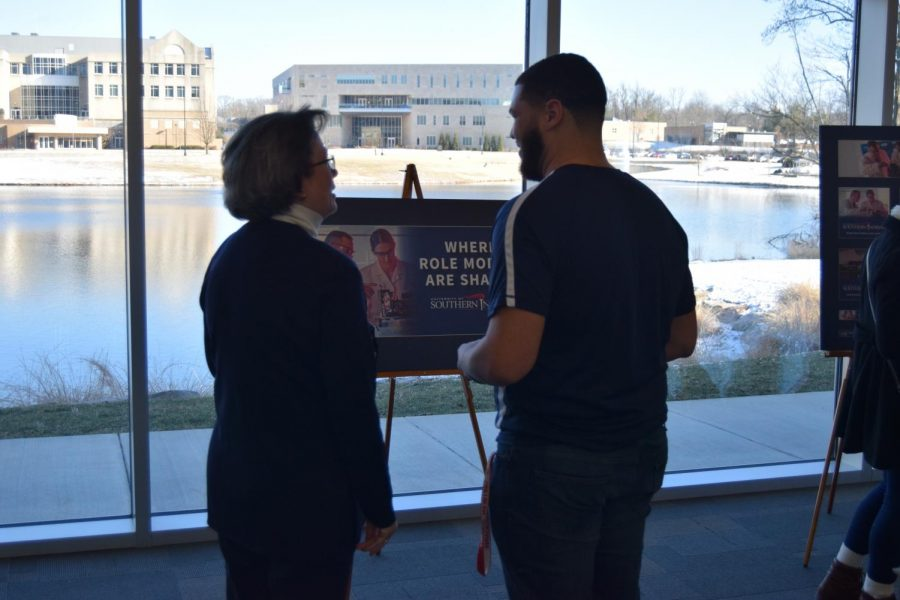 President Linda Bennett and Sophomore Elementary Education major Javontay Moss exchange looks while viewing a billboard model  Friday afternoon in the Griffin Center.