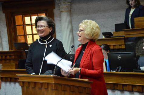 State senator Vaneta Becker (R-right) honors President Linda Bennett (left) with a resolution Feb. 12.