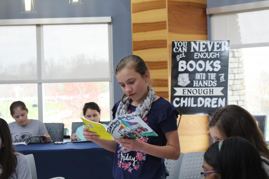 "Abigail Stallings, a seventh grader at Castle North Middle School, one of the 32 student authors who created the book ""Caring Makes the World Go 'Round"" reads a poem aloud during the official book launch in the Traditions Lounge Tuesday afternoon."