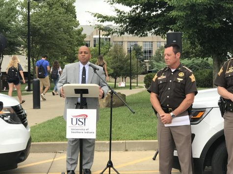 University President Ron Rochon (left), and Vanderburgh County Sheriff Dave Wedding (right) greet members of the media outside Rice Library Aug. 21 to formally announce a USI-VCSO security partnership.