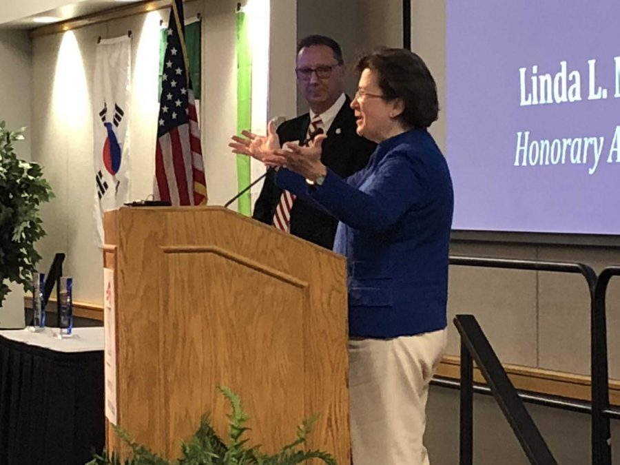 Former USI President Linda Bennett speaks at Founder's Day to a crowd of trustees, faculty, students, administration and alumni.