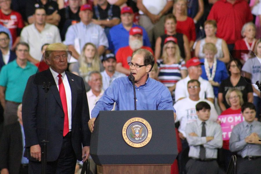 President Trump stands next to Mike Braun, a candidate for U.S. Senate, as he addresses the crowd of thousands during the rally Thursday evening.