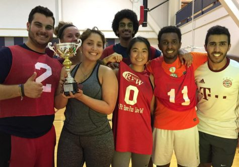 Students celebrate their win during the African Cultures Club Futsal Soccer Tournament Thursday evening.