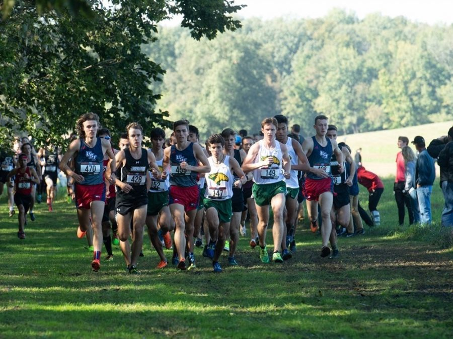 Titus Winder and Austin Nolan lead the pack of runners during a meet. The team will compete at