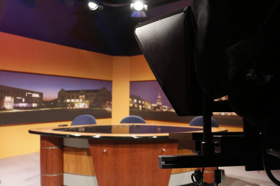 "USI graduate Lauren Leslie painted the yellow backdrop that coats the current SETV12 ""Access USI"" studio more than six years ago."