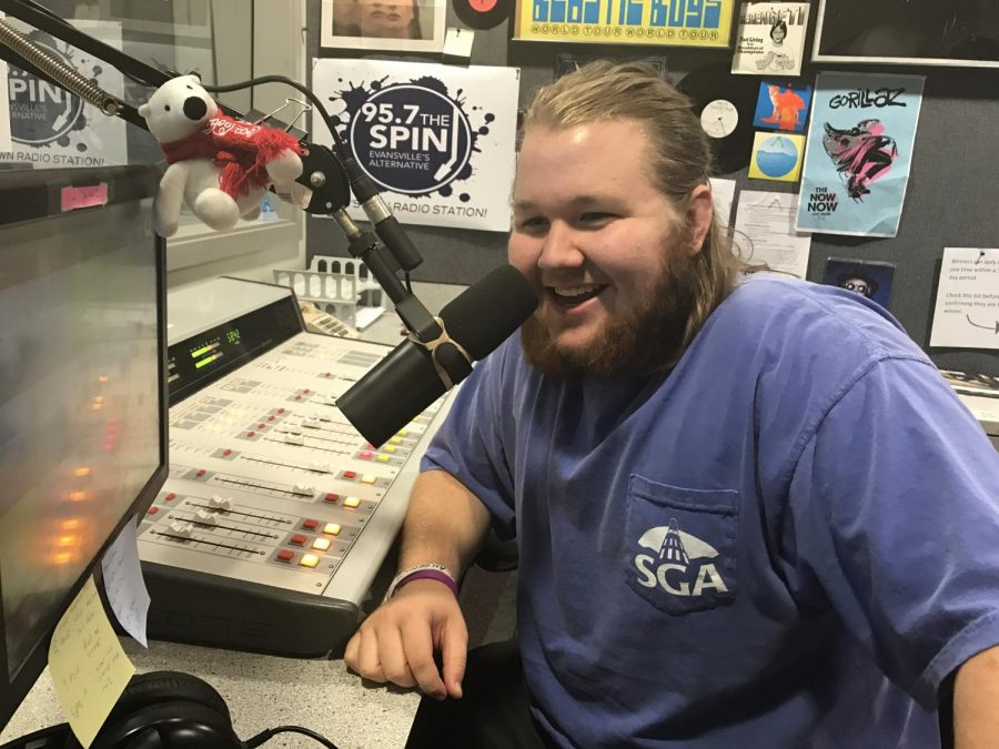 Colin McDuffee, a junior radio and television major gets ready to start the day at 95.7 The Spin.