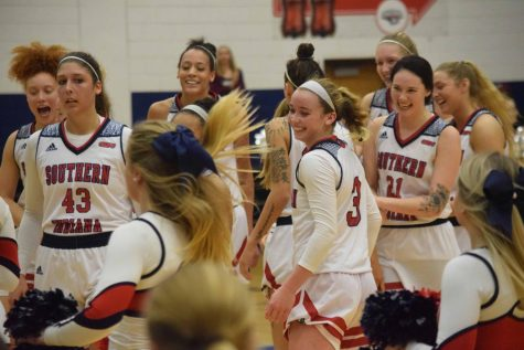 The Women's basketball team celebrates after a win.