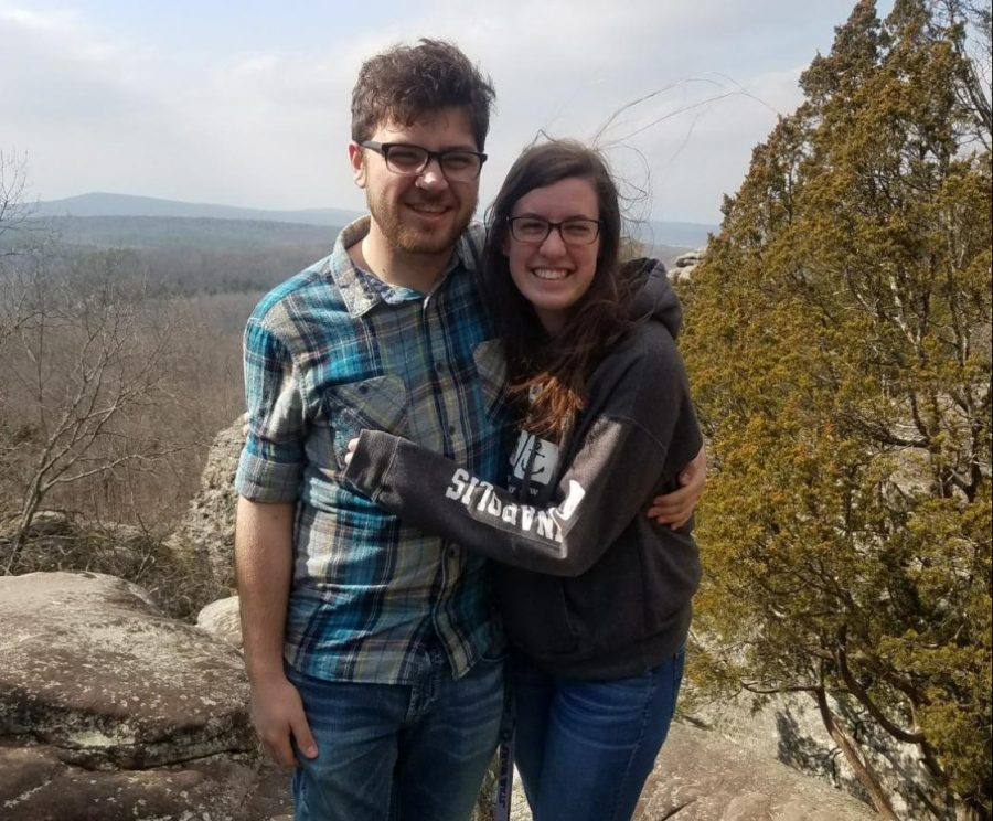 Cindy Bolander, a junior nursing major, and Ben Flora, a senior elementary education major, smile together during a hike.