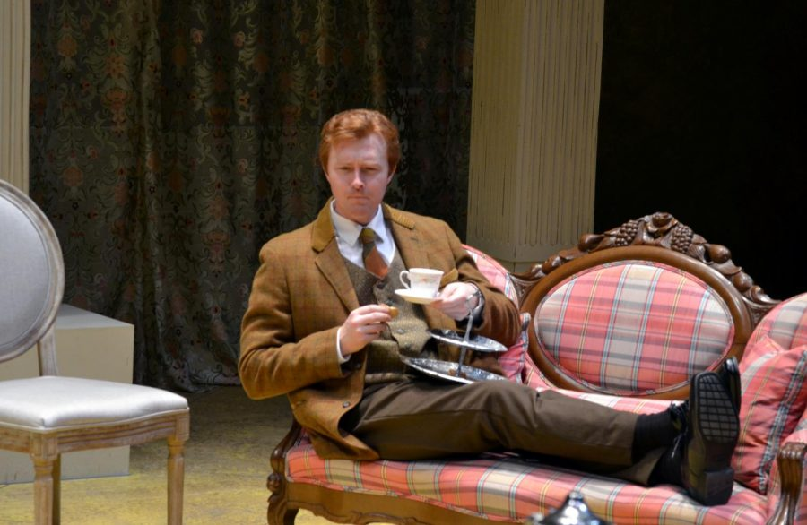 Bryan Vickery, who plays Henry Higgins, sips tea during rehearsal for