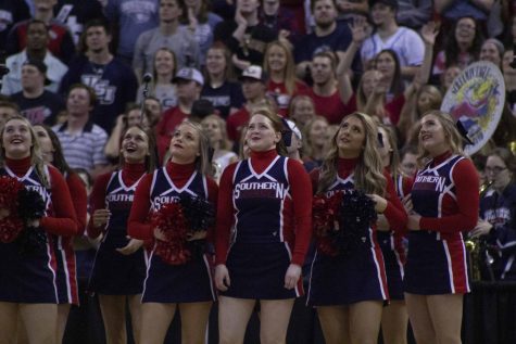 The USI Cheerleading team looks up at the jumbo Tron during a media time out.