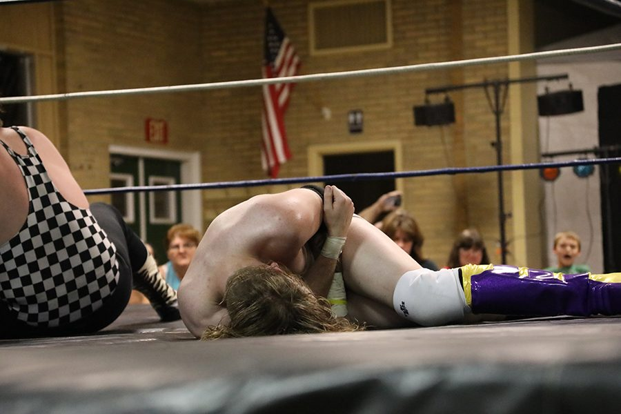 Johnny Echo grabs his arm  during the triple threat match between Blaine Black and Shank Barzini.