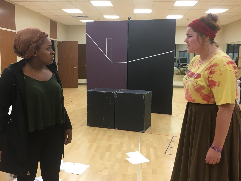 Jesmelia Williams and Cheyenne Welte, both senior performing arts majors, rehearse a scene.