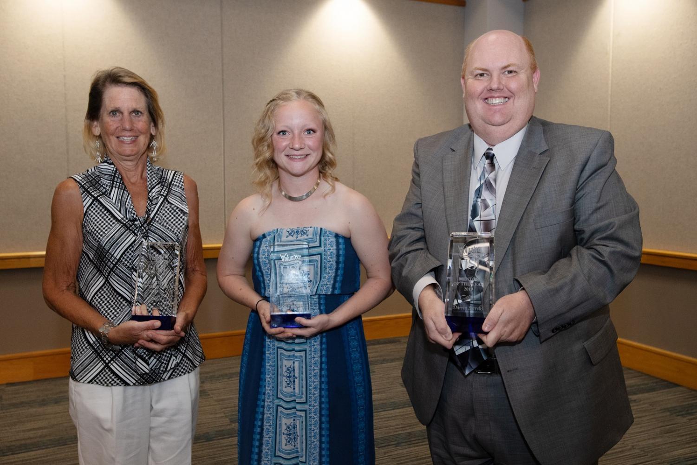 Jennie Puckett, a 2003 graduate, Darrin Sorrells, a learning assistance specialist, and Rebeka Mercker, a senior biology pre-med major, accept their awards.
