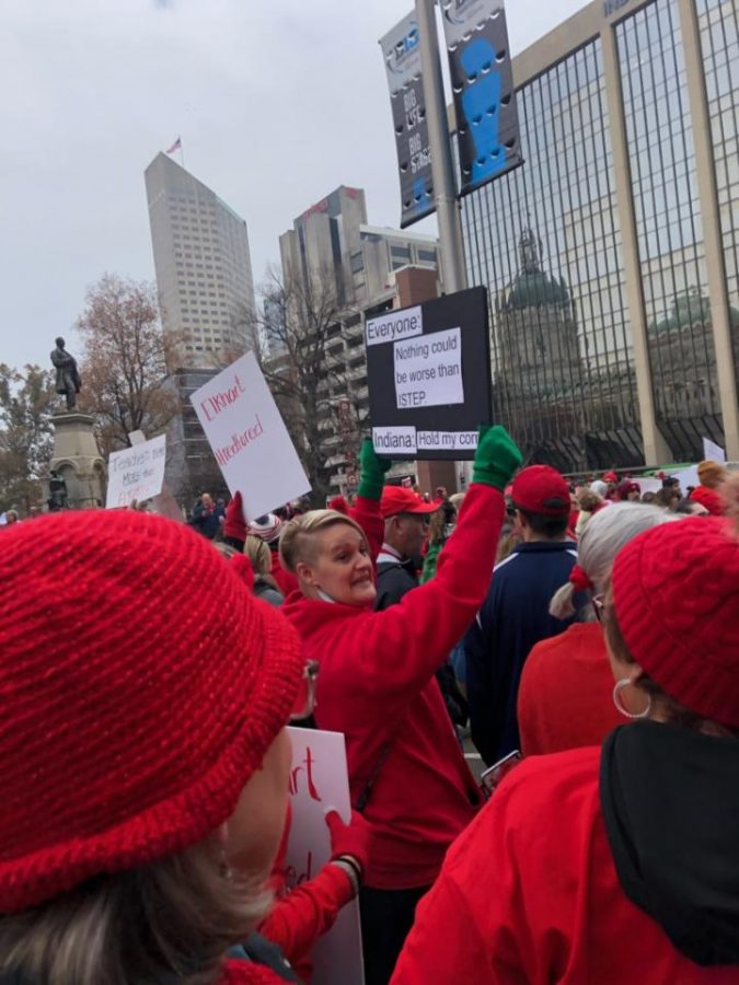 Crowd gathers around State House for Red for Ed protest