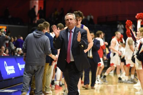 Coach Rodney Watson celebrates his 232 career win at USI after defeating Kentucky Wesleyan 82-63 at the Screaming Eagles Arena. Watson announced his retirement Monday.