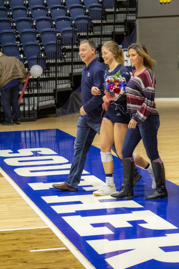 Lindsey+Stose%2C+senior+outside+hitter%2C+is+recognized+during+the+senior+day+ceremony.+The+eagles+won+against+Maryville+University+3-1.