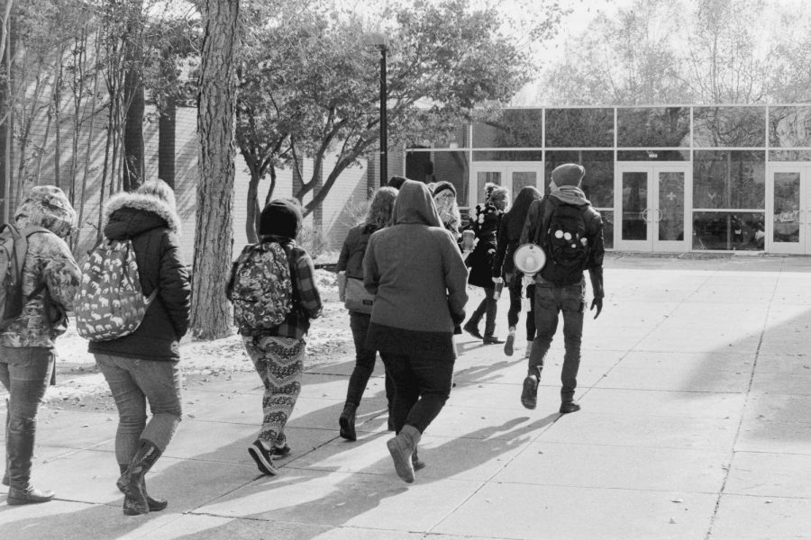 Demonstrators walks toward the Wright Administration Building hoping to visit with President Rochon.