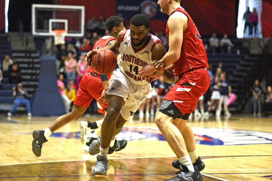 Junior forward Emmanuel Little drives to the basket against Lewis University Saturday afternoon at the Screaming Eagles Arena.