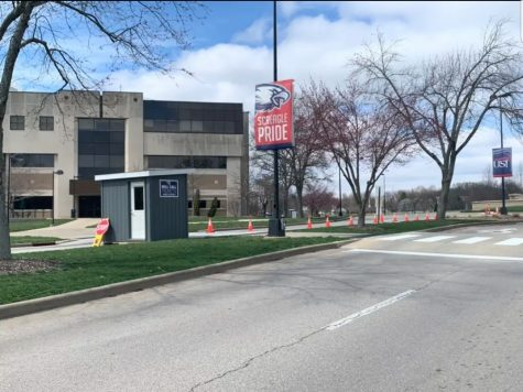 All entrances and exits besides University Boulevard are blocked off. Authorized personnel must present their university IDs before entering campus.