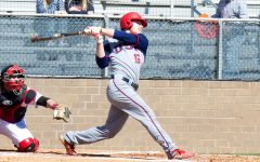 Aaron Euler, a junior outfielder, bating against William Jewell on March 3.