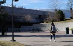 A student walks towards the University Center.