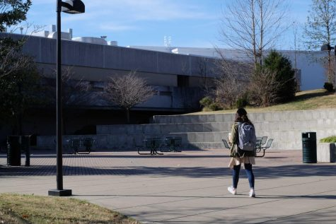A student walks towards the University Center.