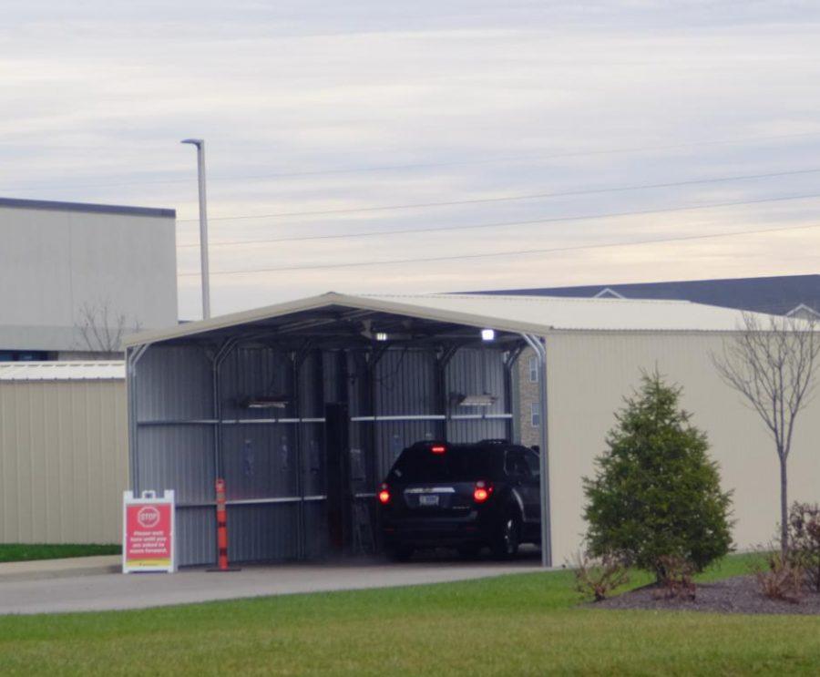 a car pulls into a drive through testing clinic
