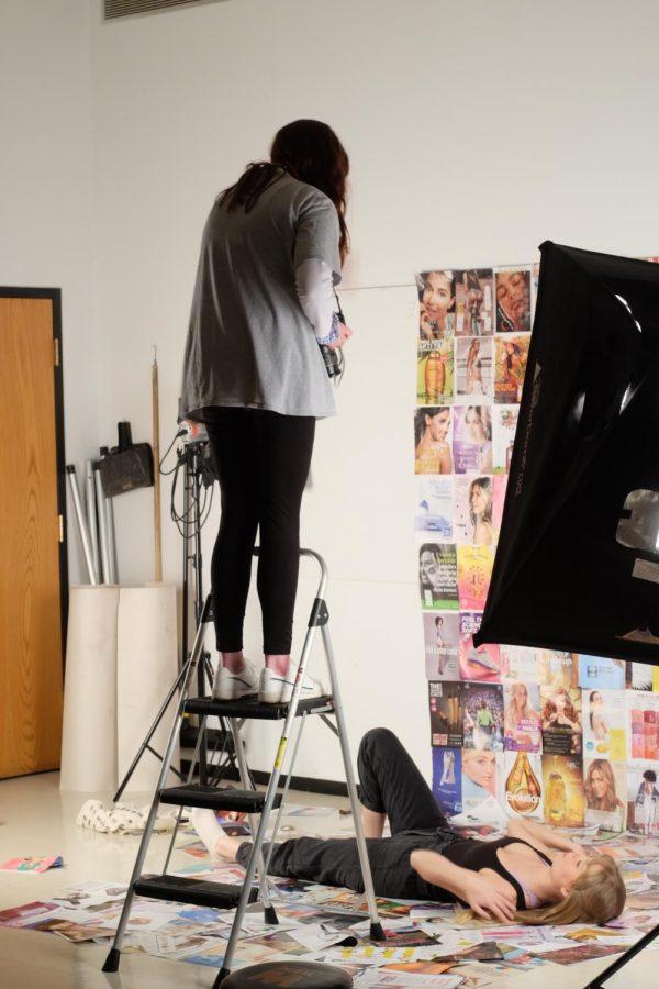 Megan Thorne directs Eleanor Samberg against a background of magazines in USIs Lighting Studio, November 6, 2020.