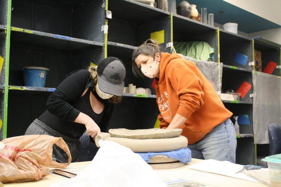 Al Holen helps Ceramics student