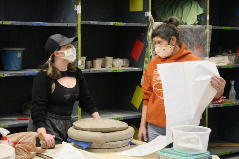 Al Holen helps Ceramics student