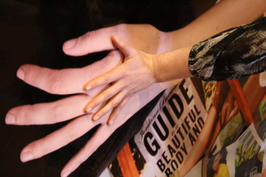 Megan Thorne puts her hand against her feature piece