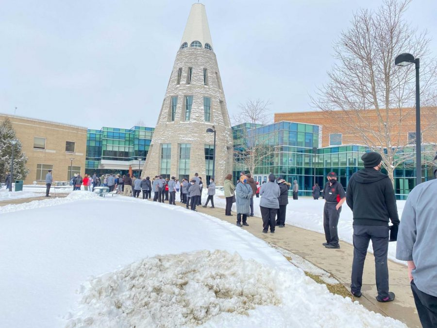 Students and faculty wait outside the University Center after a frozen sprinkler head causes a fire alarm.